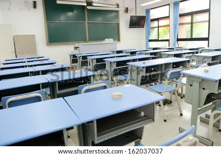 Empty classroom with chairs, desks.  - stock photo