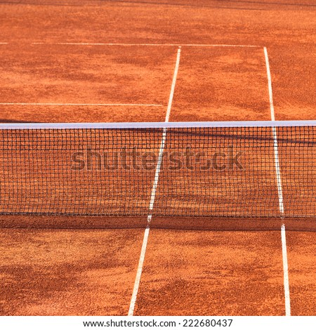 Empty Clay Tennis Court and Net. - stock photo