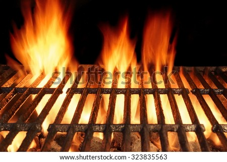 Empty Clean BBQ Cast Iron Hot Grill With Burning Charcoal Flames Of Fire Isolated On Black Background - stock photo