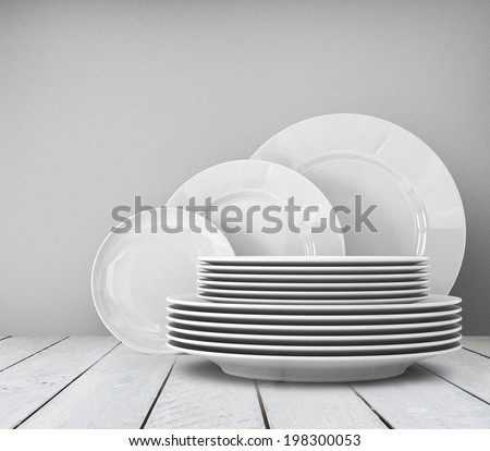 Empty clean plate on white table - stock photo