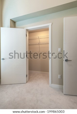 Empty Closet, Working Closet, Cupboard In Bedroom.   Stock Photo