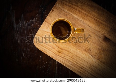 Empty coffee cup on old wooden table - stock photo