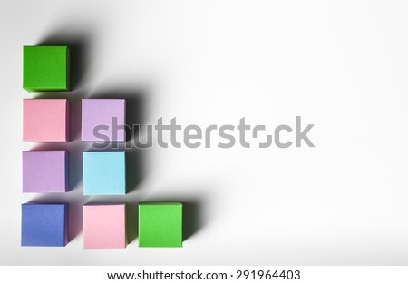 empty colorful paper cubes in a row on white background. copy space available - stock photo