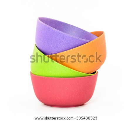 empty, colorful plastic bowl on a white background - stock photo