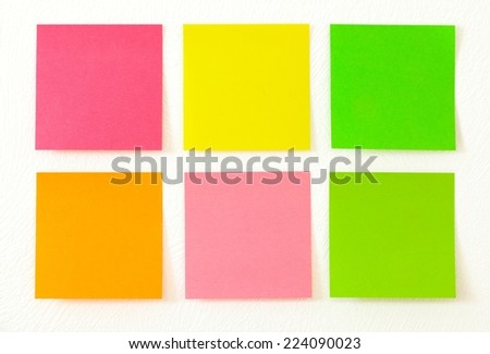 Empty colorful post its on the wall. - stock photo