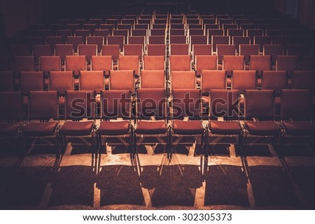 Empty comfortable red seats in a hall  - stock photo