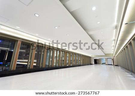 Empty corridor in modern commercial building - stock photo
