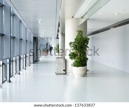 empty corridor in the modern office building. - stock photo