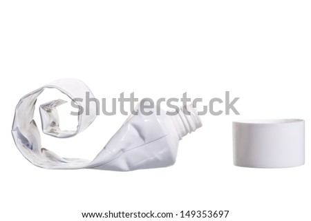 empty cosmetic tube with the lid open on a white background - stock photo