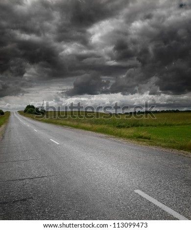 Empty countryside road - stock photo