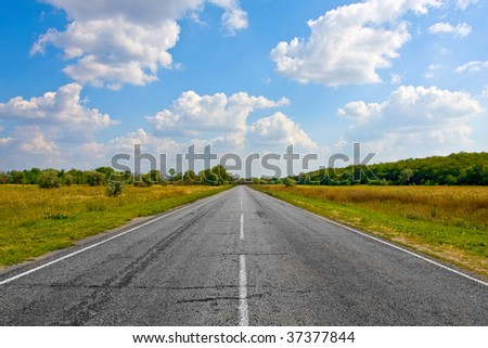 Empty countryside road at nice day - stock photo