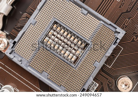 Empty CPU Socket On Computer Motherboard - stock photo