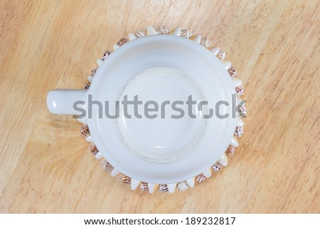 empty cup coffee  on a wooden table - stock photo