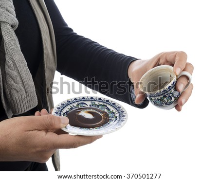 Empty cup of black coffee with coffee sediment, traditionally using for fortune telling, with copy-space  - stock photo