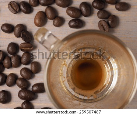 Empty Cup of hot espresso coffee and coffee crop on wood board - stock photo