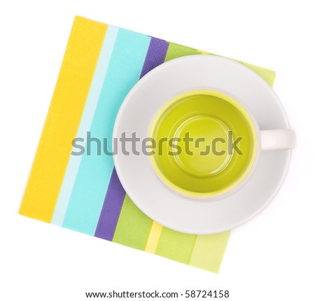 Empty cup on color placemat. Isolated on white background - stock photo