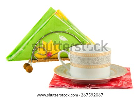 Empty cup on red napkin isolated on white background - stock photo