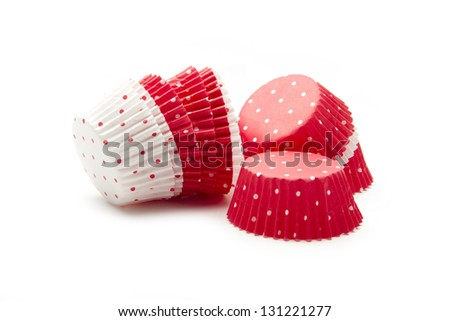 empty cups for cupcakes isolated on white background - stock photo