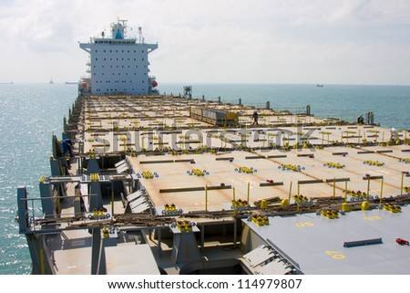 Empty deck of container ship. - stock photo