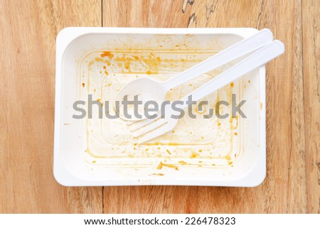 Empty dirty bowl with remains of a finished meal - stock photo