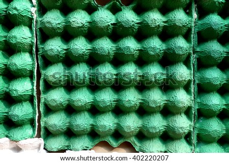empty egg carton use for cheap acoustic panel in sound record studio. - stock photo