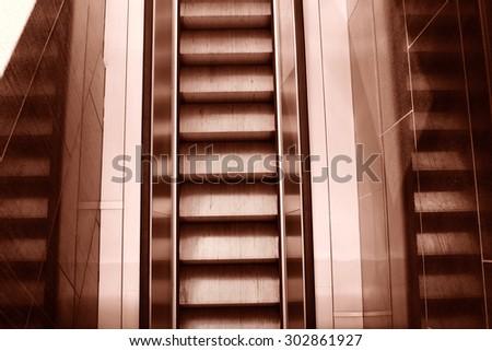 Empty escalator in a mall - stock photo