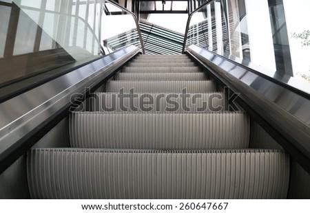 Empty escalator stairs - stock photo
