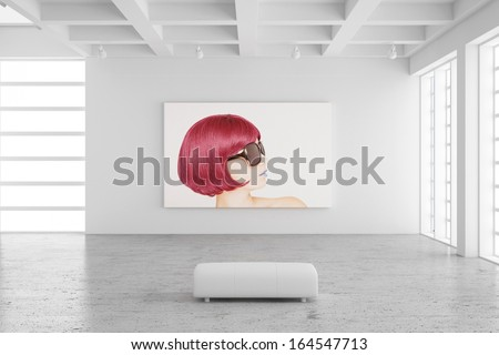 Empty exhibition hall with picture of a woman and concrete floor - stock photo