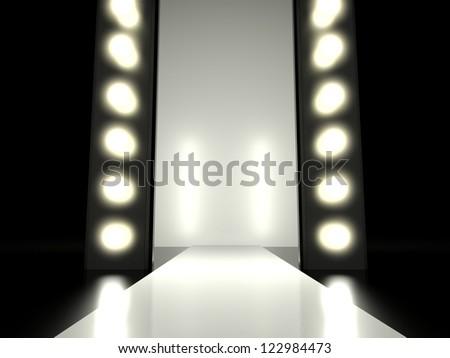 Empty fashion runway illuminated by glowing light - stock photo