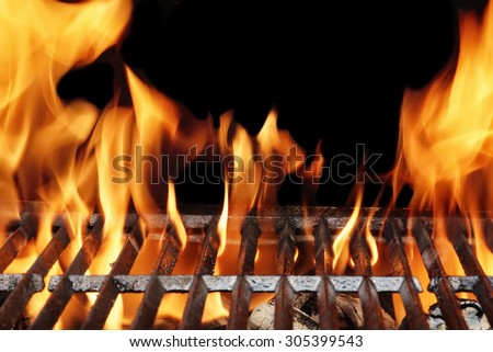 Empty Flaming Charcoal BBQ Grill With Bright Flames On The Isolated Black Background. Weekend Barbecue Party  Or Picnic Concept. - stock photo