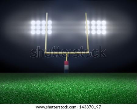Empty football field with spotlight at night - stock photo