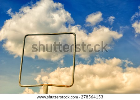 empty frame, empty sign and sky with clouds - stock photo
