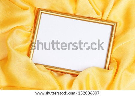 Empty frame on beautiful silk background - stock photo
