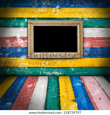 Empty frame on colorful wooden room - stock photo