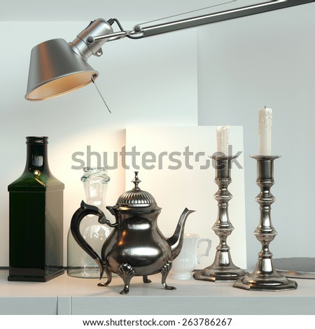 Empty frames behind the vintage crockery: coffee pot, candelabra, bottles,  under the lamp  - stock photo