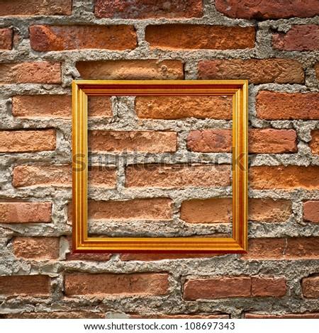 empty frames on brick wall - stock photo