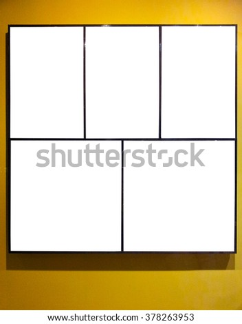 Empty frames on yeellow wall in gallery room - stock photo