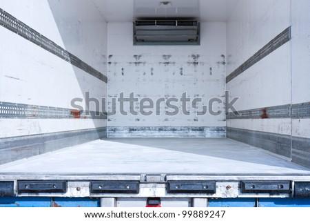 Empty freight compartment of a truck - stock photo