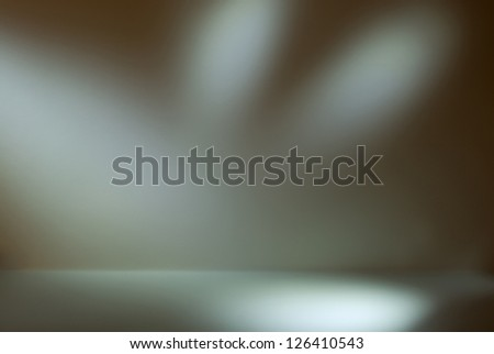 Empty gallery wall with lights for images and advertisement. In shades of green - stock photo