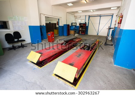 "Empty garage workshop with car stand and special equipment for repairs at car service center, ""Makhagan"" transport school, Sofia, Bulgaria, May 09, 2015.  - stock photo"