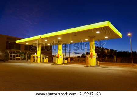 Empty gas station with blue night sky in Vuosaari, Finland - stock photo
