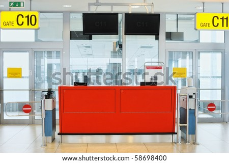 Empty gateway terminal in waiting area in airport - stock photo