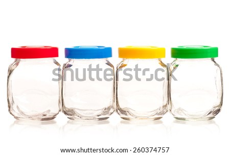 Empty glass cans with bright lids isolated on white background - stock photo