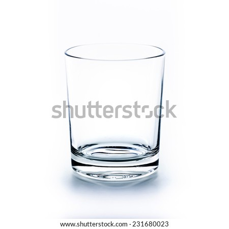Empty glass for water, beer, juice or milk on isolated white back - stock photo