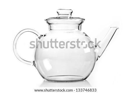 Empty glass teapot on white background - stock photo