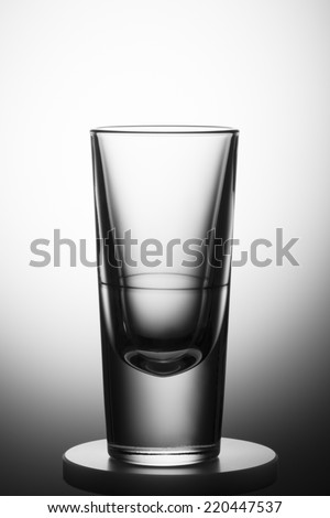 Empty glass with clear gradient background. - stock photo
