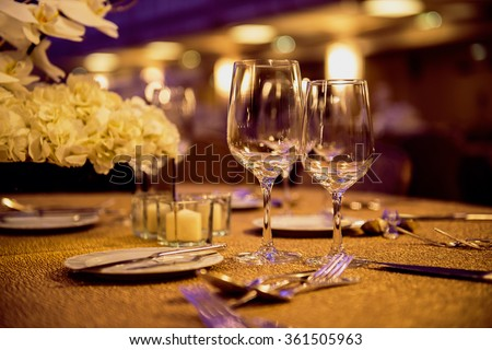 Empty glasses and dishes set in luxury restaurant  - stock photo