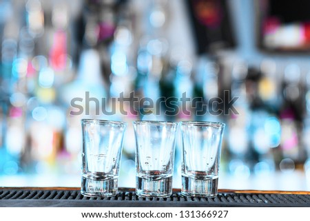 Empty glasses at a bar - stock photo