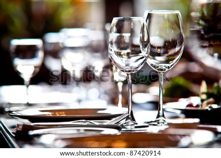 Empty glasses in restaurant - stock photo