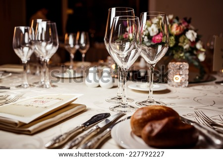 Empty glasses in restaurant. Table setting for celebration - stock photo